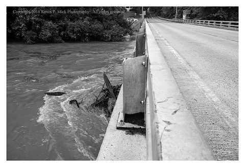 BW photograph of Detour showing the elevated water level of Double Pipe Creek-debris is against the bridge.