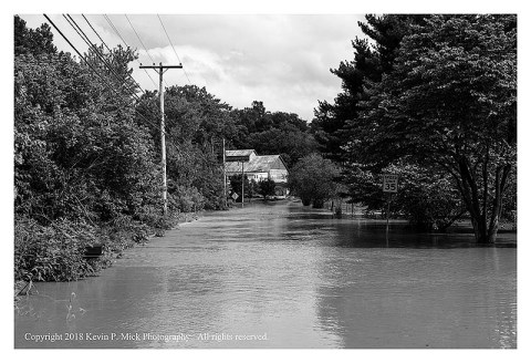 BW photograph of Detour with Double Pipe Creek flooding its banks onto a road.