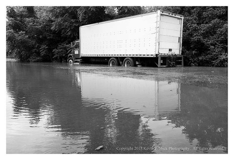 BW photograph of Detour showing the elevated water level of Double Pipe Creek-a moving truck has water to the half-wheel height.