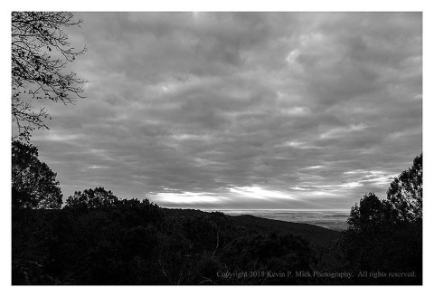 BW photograph of an overcast sky looking out toward Thurmont from Hog Rock.