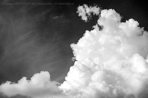 BW photograph of pre-thunderstorm cumulous clouds.