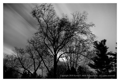 BW photograph of blurred clouds on a very windy morning.
