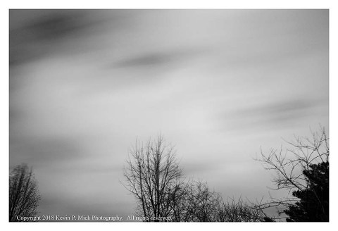 BW photogrpah of blurred clouds on a very windy morning.