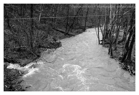 BW photograph of a view from the road of a flooded Morgan Run.