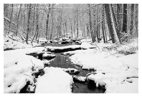 BW photograph of snow covered rocks at Morgan Run.