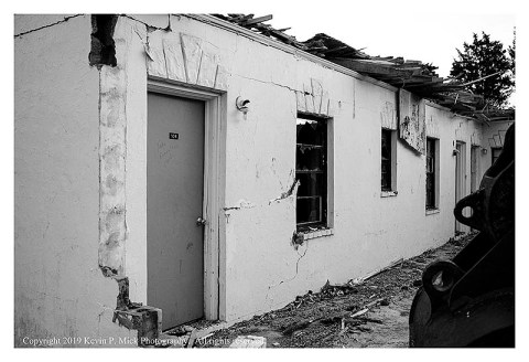 BW photograph of a door at the being demolished Sands Motel.