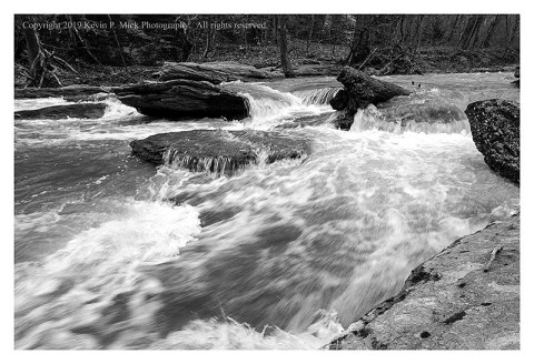 BW photograph of Morgan Run still rushing after a flood even though it was clear that the water had receeded.