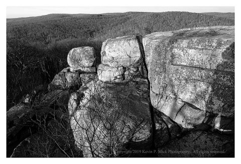 BW photograph of Chimney Rock in the early morning.