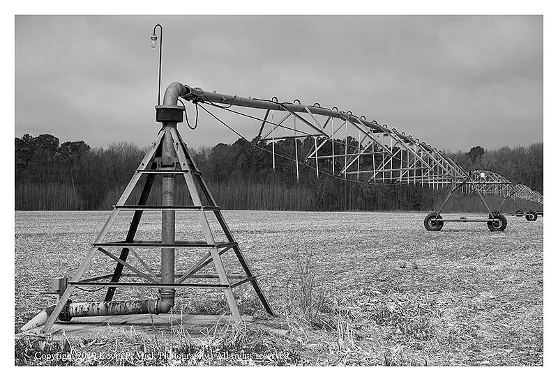 BW photograph of a large irritagion pipe.