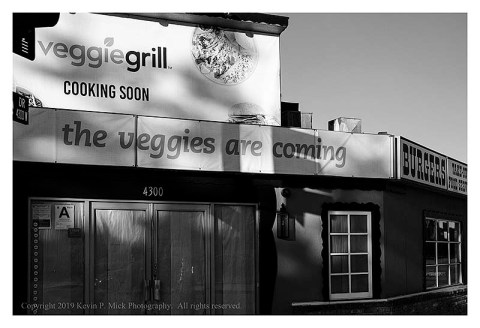 BW photograph of a burger restaurant transitioning to the Veggie Grill.