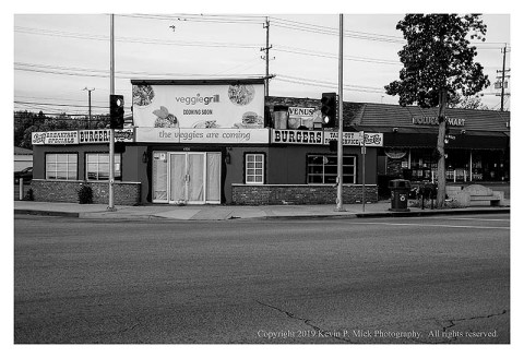 BW photograph of the upcoming Veggie Grill from across the street.