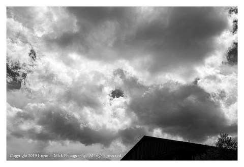 BW photograph of the cloud bank into which a plane just flew.