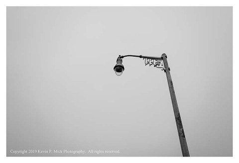 BW photograph looking up at a streetlamp in Baltimore, MD.
