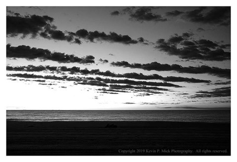 BW photograph of the pre-sunrise over the Atlantic Ocean.
