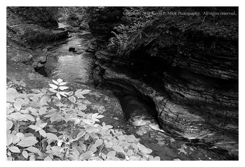 BW photograph of the top of Buttermilk Falls.
