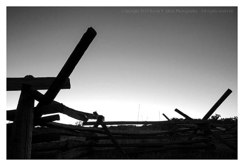 BW photograph of a rail fence in Gettysburg at sunrise.