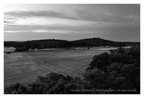 BW photograph looking from Confederate Ave. toward the Round Tops.