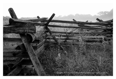 BW photograph of a split rail fence around the Wheat Field in Gettysburg.