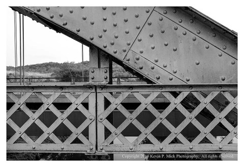BW photograph of a section of bridge highlighting the rivet work.