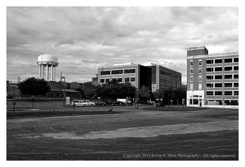 BW photograph of a water tower-long, wide composition.
