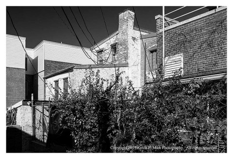BW photograph of several brick structures.