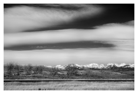 BW photograph of the snow-covered mountains outside of Livingston, Montana.