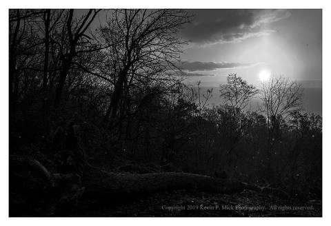 BW photograph of a snow squall looking into the rising sun.