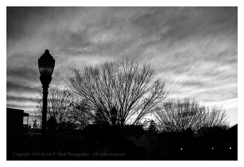 BW photograph of the sun setting in Frederick, MD.