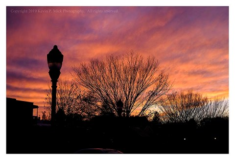 Colour photograph of the sun setting in Frederick, MD.