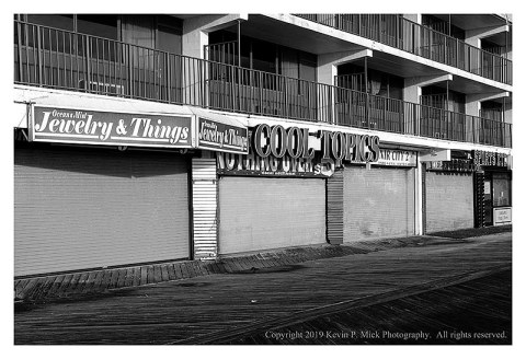 BW photograph of closed store fronts on the boardwalk.