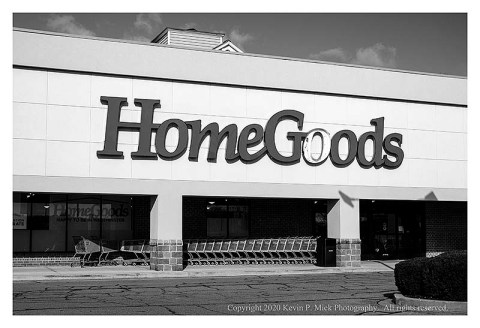 "BW photograph of a Home Goods with one ""o"" blown out from a storm."
