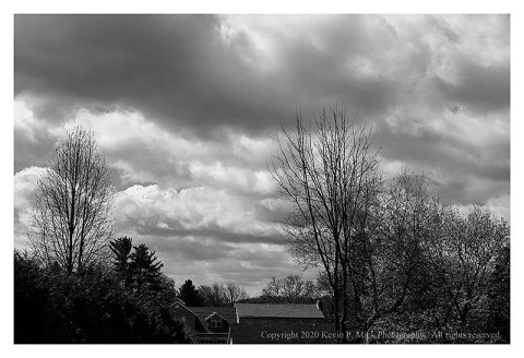 BW photograph of heavy clouds on a windy day.