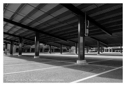 BW photograph of an empty college parking lot.