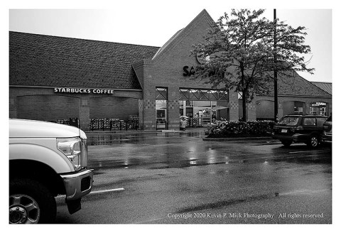 BW photograph of a Safeway on a rainy morning.