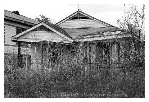BW photograph of a broken house three years after Katrina.