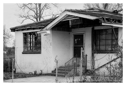 BW photograph of a destroyed house three years after Hurricane Katrina.