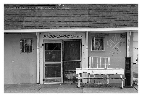 BW photograph of an abandoned store in the 9th Ward three years after Hurricane Katrina.