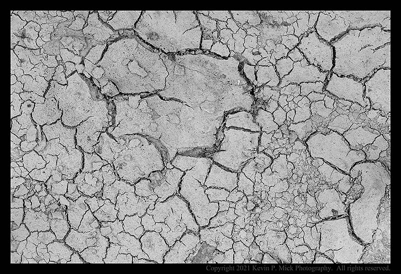 BW photograph of dried, cracked, mud.