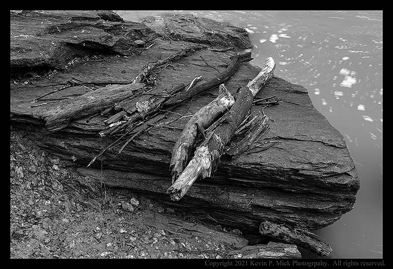 BW photograph of debris on a large boulder after a thunderstorm.